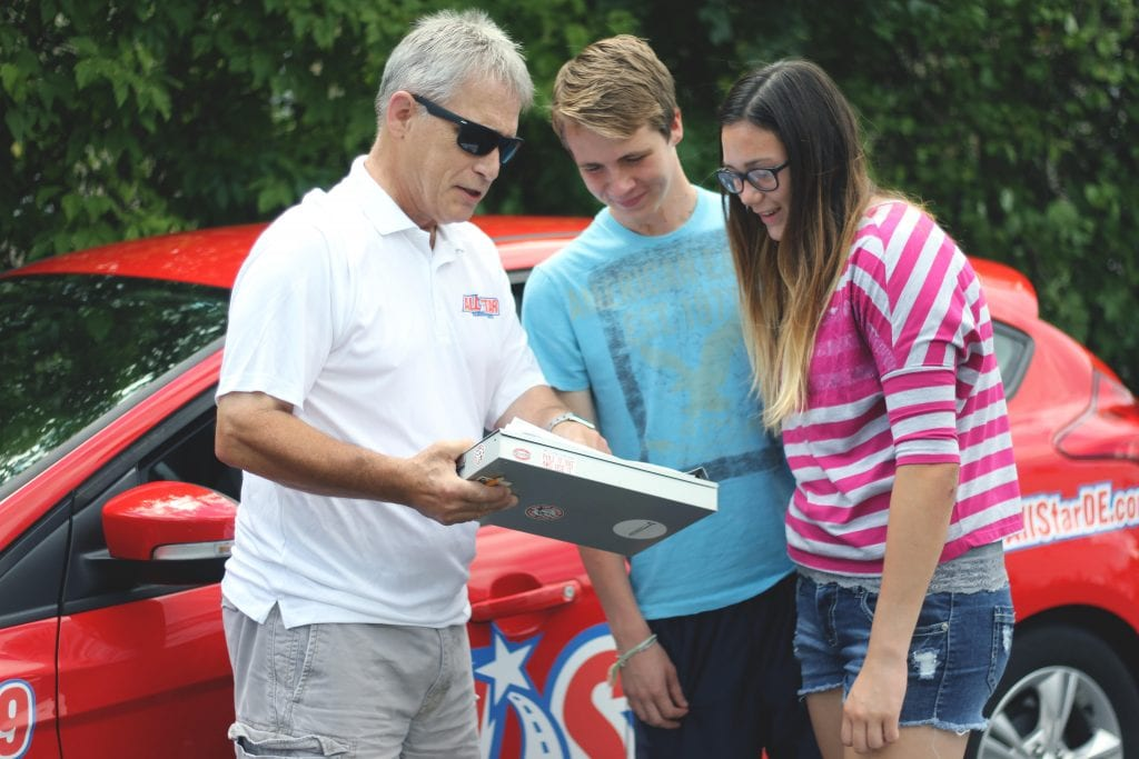 instructor Dave showing clipboard to students